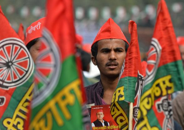 A supporter listens to a speech by India's Uttar Pradesh state Chief Minister Akhilesh Yadav during a...