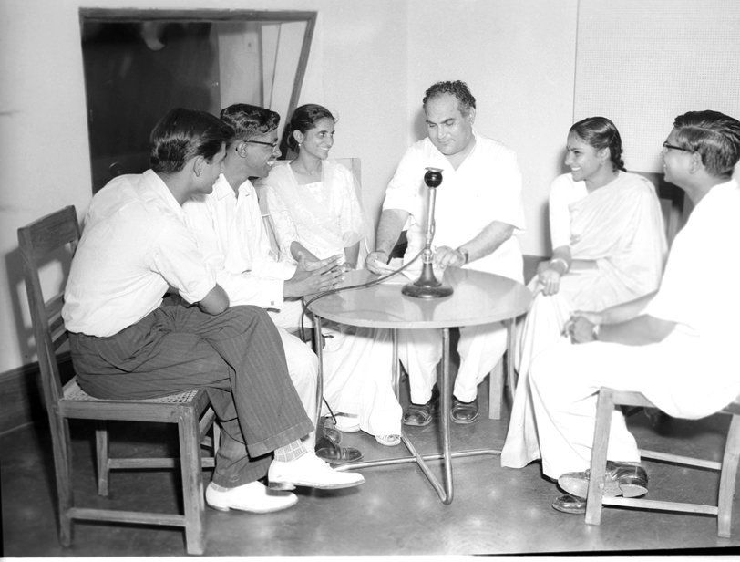 A discussion among students, conducted by M.M. Beg, being recorded at the All India Radio, New Delhi...