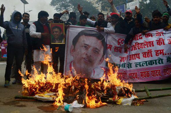 Supporters of Uttar Pradesh's Chief Minister Akhilesh Yadav burn the symbolic last ride effigy of Amar...