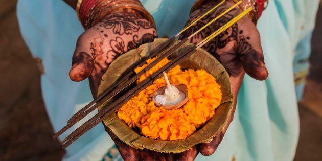 Decorated hands holding traditional offering, Allahabad, Uttar Pradesh,