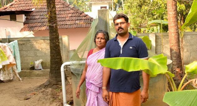 Komalam Ramachandran of Naduvilkara in Thrissur district and her son in front of the well in their