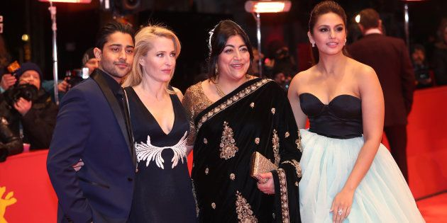 Actor Manish Dayal (L-R), actress Gillian Anderson, director and screenwriter Gurinder Chadha and actress Huma Qureshi arrive for the screening of the movie 'Viceroy' s House' at the 67th Berlinale International Film Festival in Berlin, Germany, February 12, 2017.