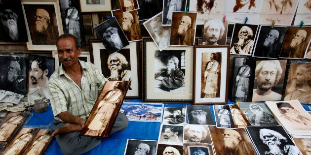A street vendor in Kolkata sells photographs of Indian poet Rabindranath Tagore on a pavement during...