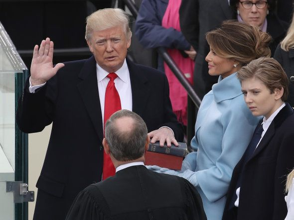 Supreme Court Justice John Roberts (2L) administers the oath of office to U.S. President Donald Trump...