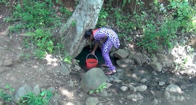 A dirty ditch is the only source of water in Kulappadi village