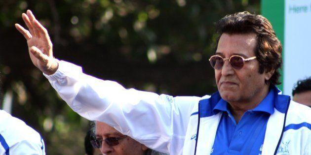 Indian Bollywood celebrity Vinod Khanna poses during the Standard Chartered Mumbai Marathon (SCMM) 2012...