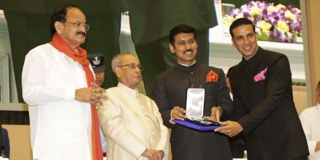 Akshay Kumar receiving the Best Actor National Award from President Pranab Mukherjee in New Delhi while I&B Minister M. Venkaiah Naidu and Minister of State Rajyavardhan Rathore look on