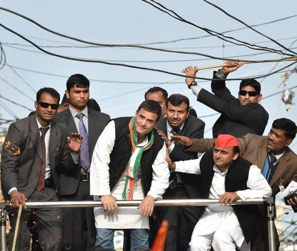 Lucknow : A security person pushing away elctric cables above Uttar Pradesh Chief Minister and Samajwadi...