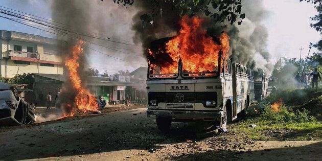 Vehicles are seen burning after being set alight by protesters in Imphal, the capital of Indias northeastern...