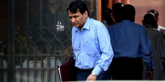 Congress Workers Garland Suresh Prabhu With Black Cloth For 'Indifference' Towards Railways In