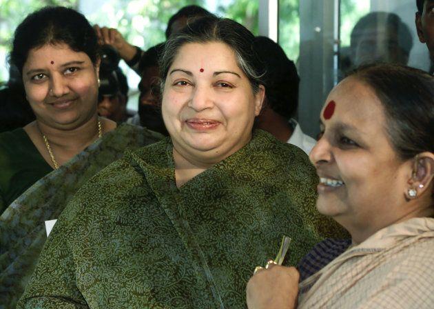 Jayaram Jayalalitha (C), leader AIADMK, arrives with her companion Sasikala Natarajan (L) in Madras,...