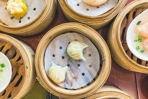 High Angle View Of Chinese Dumplings In Containers On Table