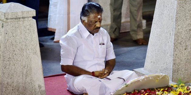 Tamil Nadu Chief Minister O Panneerselvam sitting in a meditation in front of late J Jayalalithaa's burial...