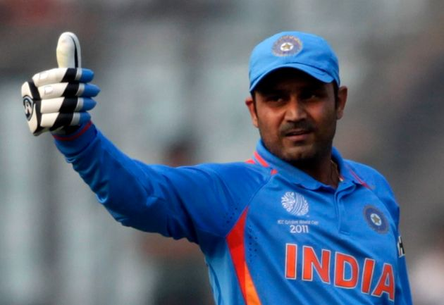 India's Virender Sehwag celebrates after he scored his century during the ICC Cricket World Cup group...