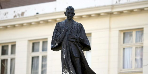 A statue of Mahatma Gandhi is seen after it was vandalized with white paint at Ghandi Square in Johannesburg...