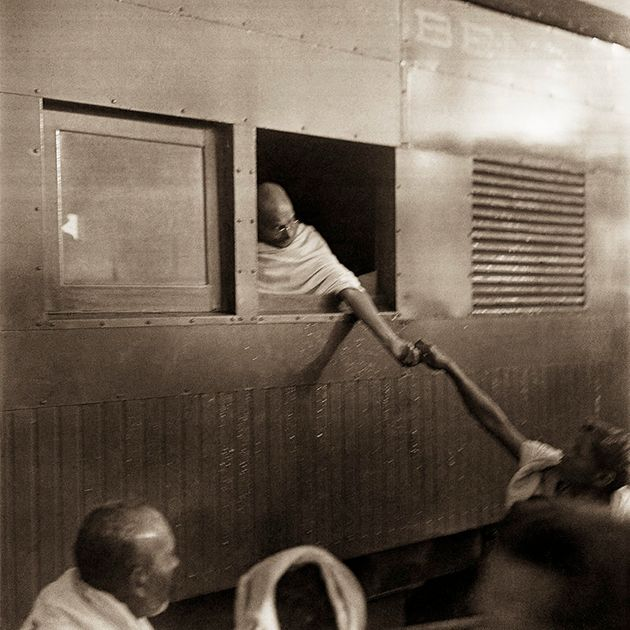 Mahatma Gandhi collecting donations for the Harijan Fund during his train journey to Bengal, Assam and...