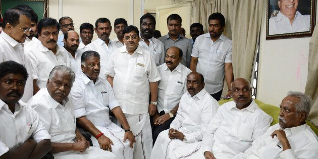 Chief Minister of the southern Indian state of Tamil Nadu O.Paneerselvam (bottom, 3L) is surrounded by...