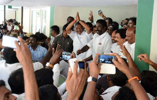 Acting Chief Minister of Tamil Nadu, O. Paneerselvam (C), gestures during a press conference at his home...