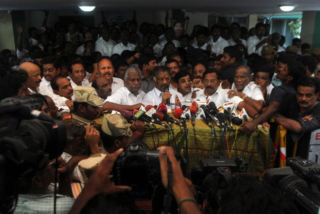 Acting chief minister O Panneerselvam (C) of the southern Indian state of Tamil Nadu speaks at a press...