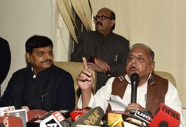 Samajwadi Party Chief Mulayam Singh Yadav with Amar Singh and Shivpal Yadav briefs media at his Delhi...