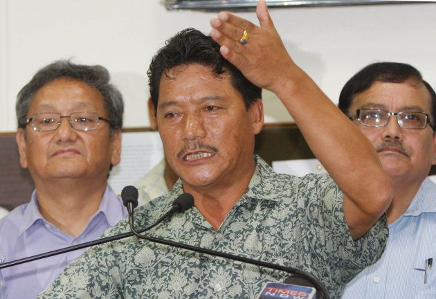 Gorkha Janmukti Morcha chief Bimal Gurung speaks during a press conference after meeting with chief minister...
