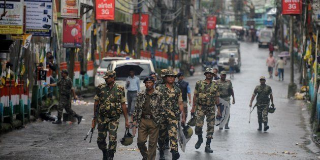 Indian paramilitary forces patrol during a strike demanding a new Indian state at Kalimpong town, some...