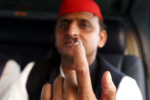 Uttar Pradesh state Chief Minister Akhilesh Yadav Shows his marked finger one day after casting his vote...