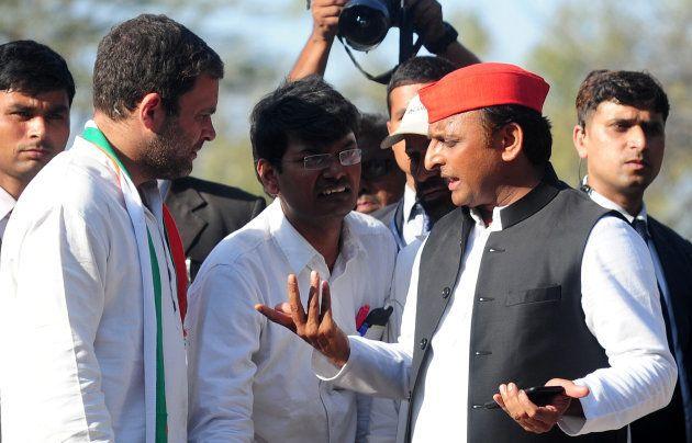 Chief Minister of Uttar Pradesh and Samajwadi Party leader Akhilesh Yadav (R) and Congress Party vice-...
