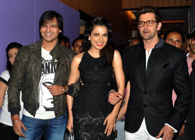 Indian Bollywood actors Hrithik Roshan (R) and Vivek Oberoi (L) pose with actress Kangana Ranaut (C) during a promotional event for the forthcoming Hindi film Krrish 3 Halloween party in Mumbai late October 30, 2013.