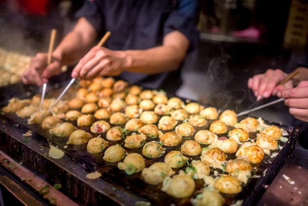 Takoyaki are made in round molds like
