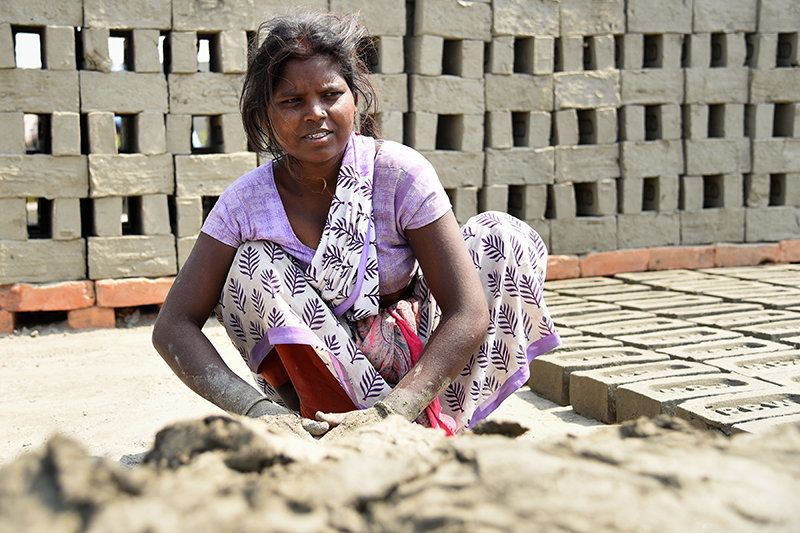 "Reshma says, ""I have been coming to work in the brick kiln for the past 13 years with my husband. There are no jobs in southern Bihar. My four children are also with me, I have no options to keep them at home."""