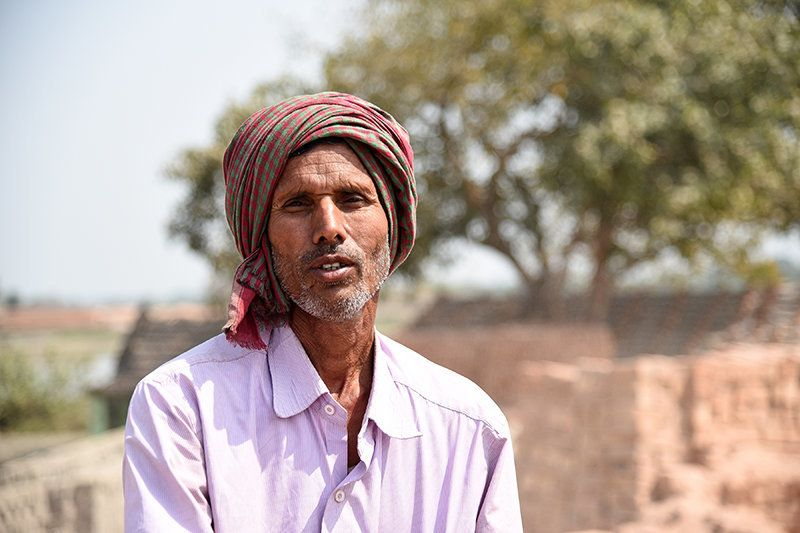 """Every year I come to Bengal from November to June. Here the rate is higher than Uttar Pradesh. Sometimes we have to work overtime. There are local level brokers (sardar) in villages, they get good commissions but we have no options,"" says Narmu Yadav, from Gazipur, Uttar Pradesh, who controls the fire inside brick kiln."