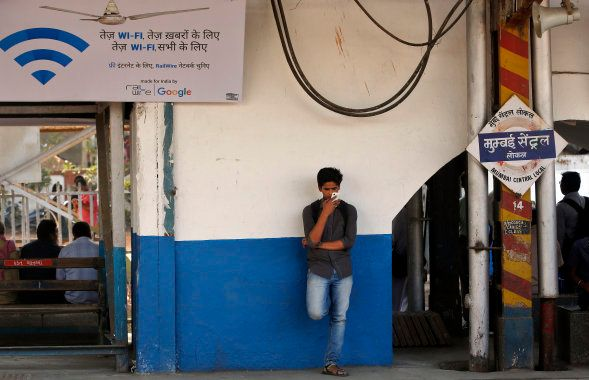 An Indian traveler uses a free WiFi