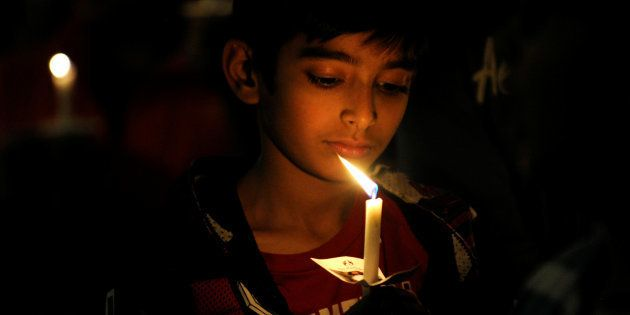 An attendee holds a candle during a vigil for Srinivas Kuchibhotla, an Indian engineer who was shot and...