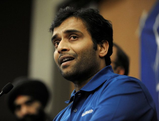 Alok Madasani, who was wounded in a shooting that killed Indian engineer Srinivas Kuchibhotla, attends...