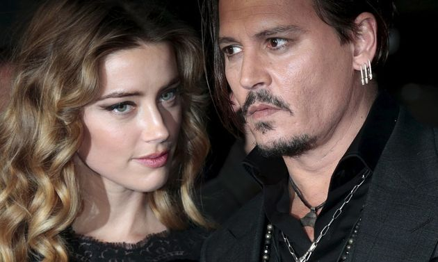 Johnny Depp and his actress wife Amber Heard arrive for the British premiere of the film