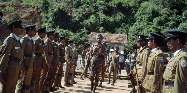 TRINCOMALEE, SRI LANKA: Indian Army soldiers from the Indian Peacekeeping Forces, IPKF, prepare to withdraw...