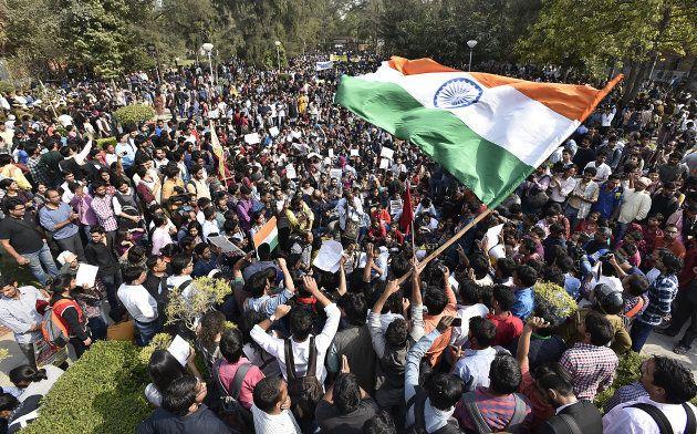 Students and teachers sitting near Vivika Nand statue during the AISA, JNUTA, and Delhi University Students'...