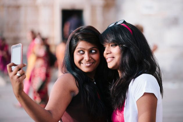 Two young women pose for a self portrait,