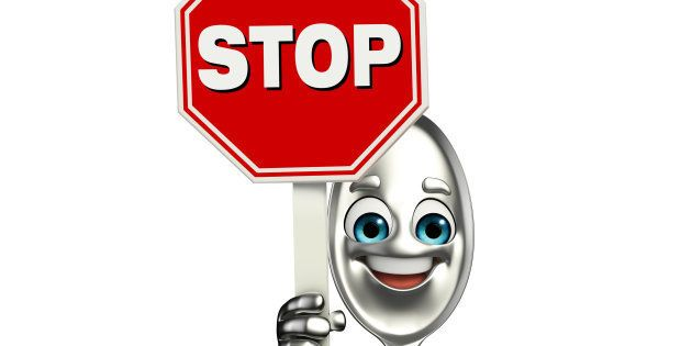 Cartoon character of Spoon with stop sign