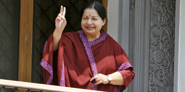 Jayalalithaa, leader of Anna Dravida Munetra Khazhgam (AIADMK) flashes a victory sign toward her supporters...