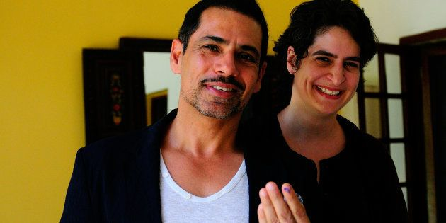 NEW DELHI, INDIA - APRIL 10: Robert Vadra with his wife Priyanka Gandhi showing vote marks on his finger...