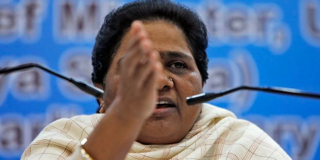 India's Bahujan Samaj Party (BSP) Chief Mayawati gestures as she address the media during a news conference...