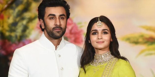 Indian Bollywood actors Ranbir Kapoor (L) and Alia Bhatt pose for a picture during the wedding reception...