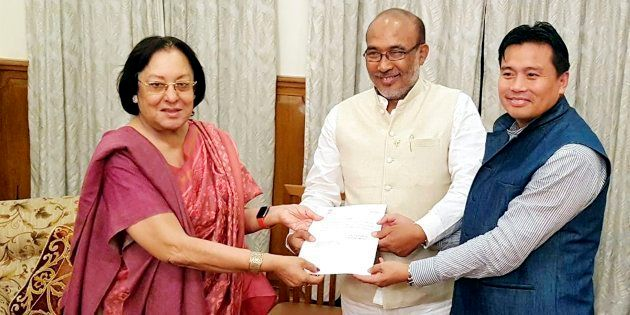 Manipur Governor Najma Heptulla handing over the invitation letter to BJP leader Nongthombam Biren Singh...