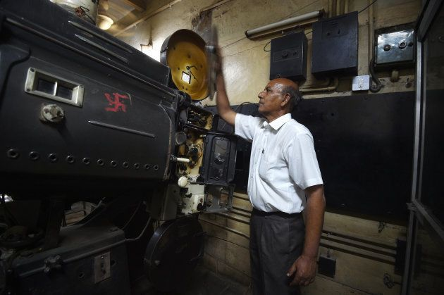 This picture taken on March 27, 2017 shows Indian projectionist Ramesh Kumar, who has worked at the Regal...