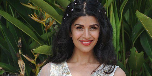 Indian Bollywood actress Nimrat Kaur poses for a photograph at Lakm�Fashion Week (LFW) Summer Resort...