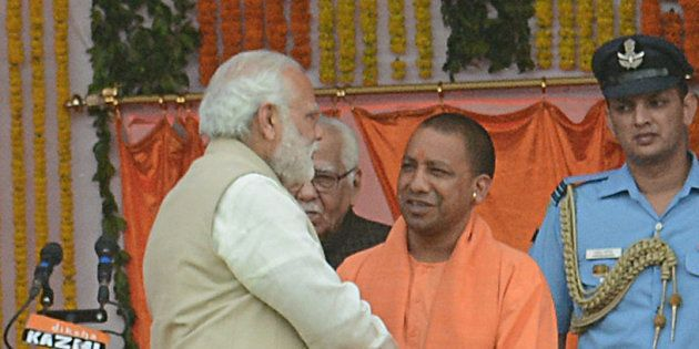 UP CM Yogi Adityanath and Prime Minister Narendra Modi with other party leaders during the swearing-in...