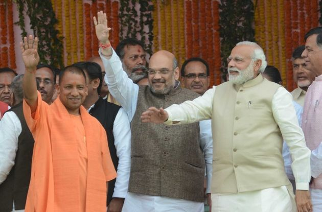 LUCKNOW, INDIA - MARCH 19: BJP President Amit Shah, UP CM Yogi Adityanath and Prime Minister Narendra...