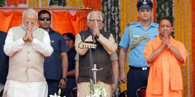 Prime Minister Narendra Modi (L), Uttar Pradesh governor Ram Naik (C) and Yogi Adityanath (R) greet a...
